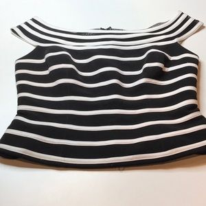Cache black and white form fitting top with peplum